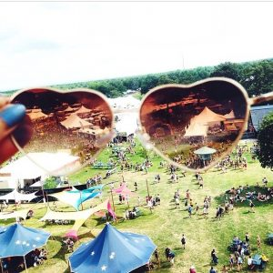 view from ferris wheel through heart glasses