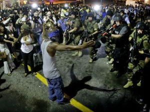 protestor in police circle