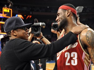 Cleveland Cavaliers forward LeBron James greets entertainer Jay-Z after his team beat the New York Knicks in New York